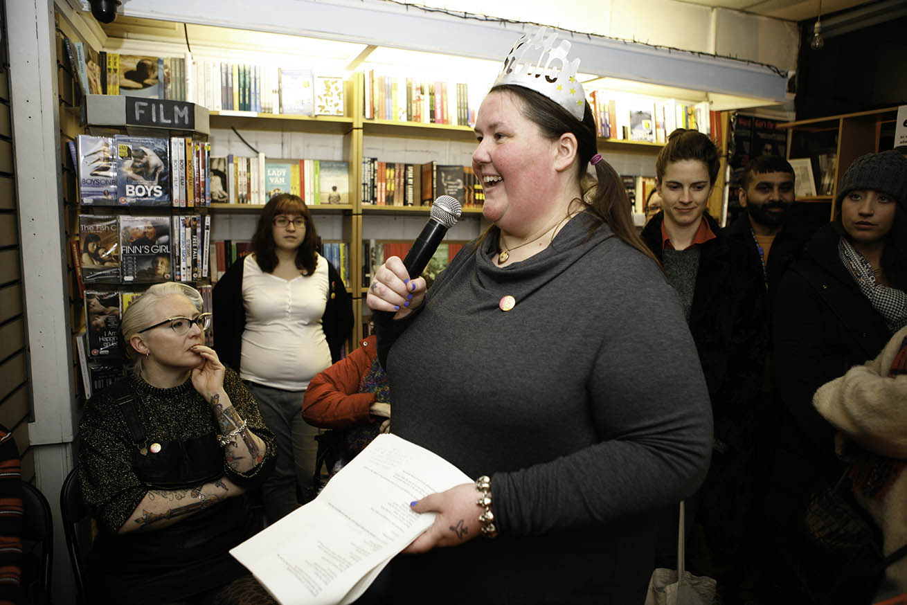 Charlotte Cooper speaks into a microphone at the Fat Activism Book launch