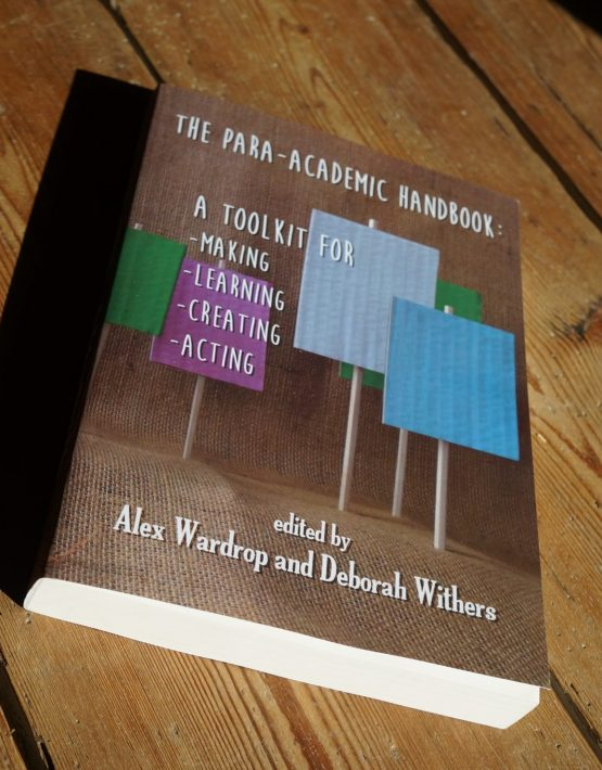 Para-Academic Handbook cover, a series of blank placards, photograph by Rachael House