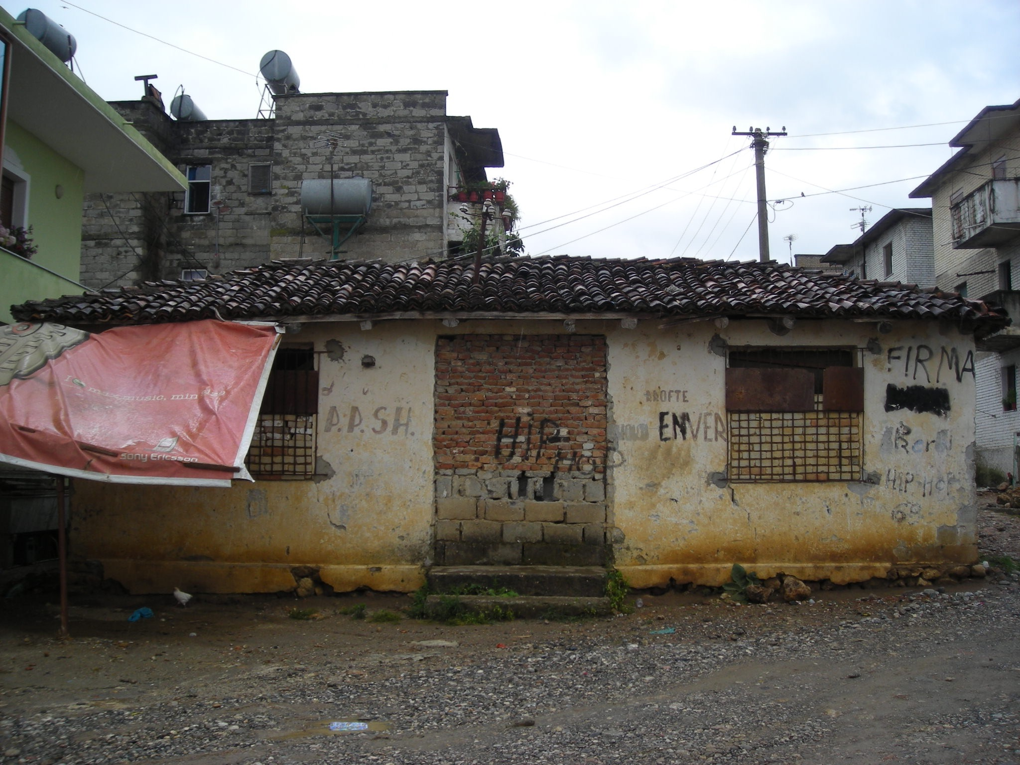 Abandoned building with graffitti on exterior