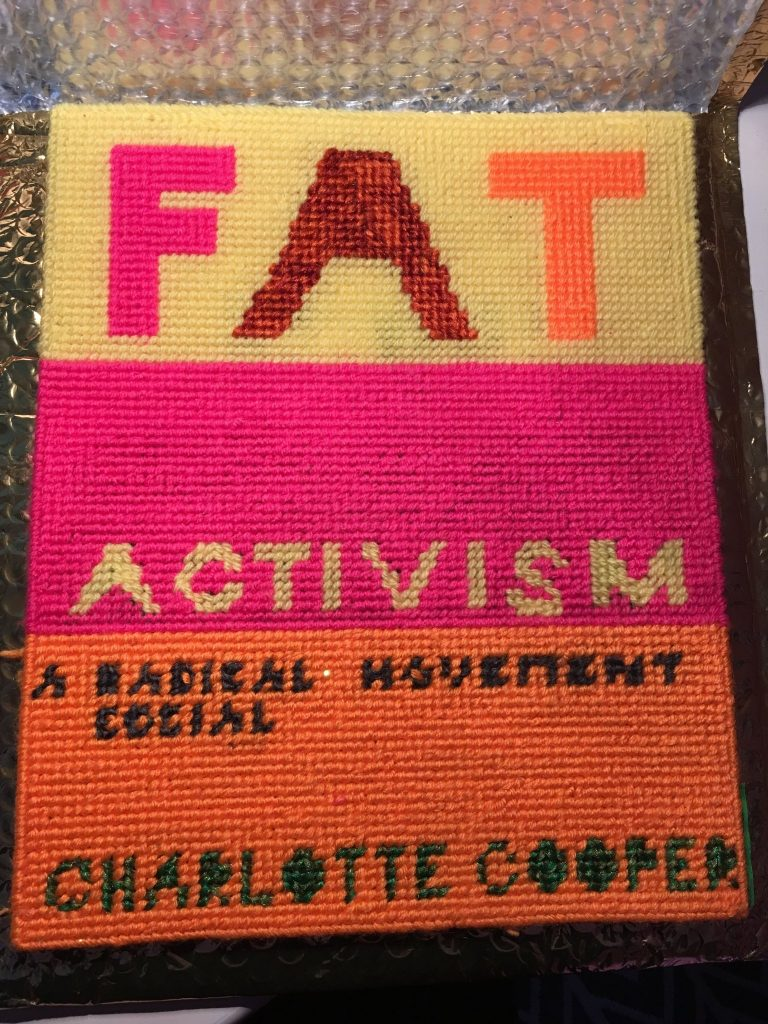crocheted version of Fat Activism cover created by Allyson Mitchell
